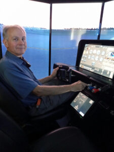 Mike, ground school instructor, simulator